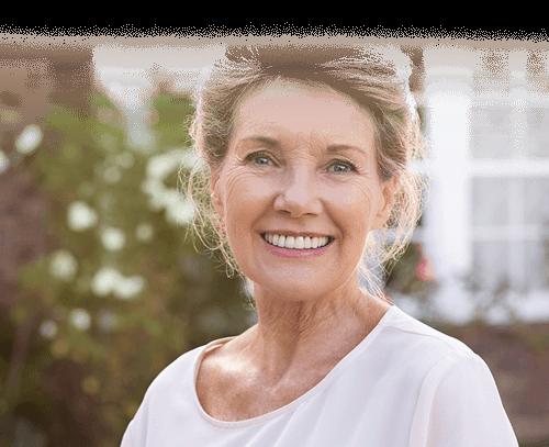 smiling older woman outside