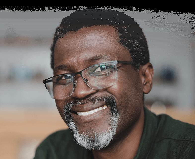 smiling senior man with glasses at senior living center