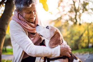 woman with beagle enjoying senior living community amenities in naples fl