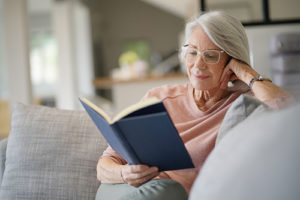 a woman reading at a Senior Assisted Living Homes Sun City Center FL