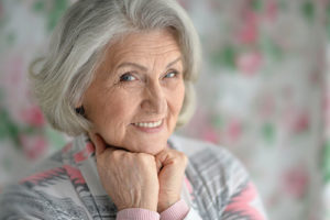 woman thinking about Parkland Florida Residential Senior Living Options