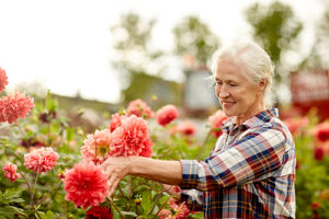 senior woman learning about the gardening Florida Residential Senior Living Options