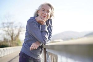 senior woman exploring a bridge during Naples Florida senior living activities
