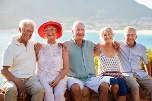seniors at the beach using residential senior living options in naples florida