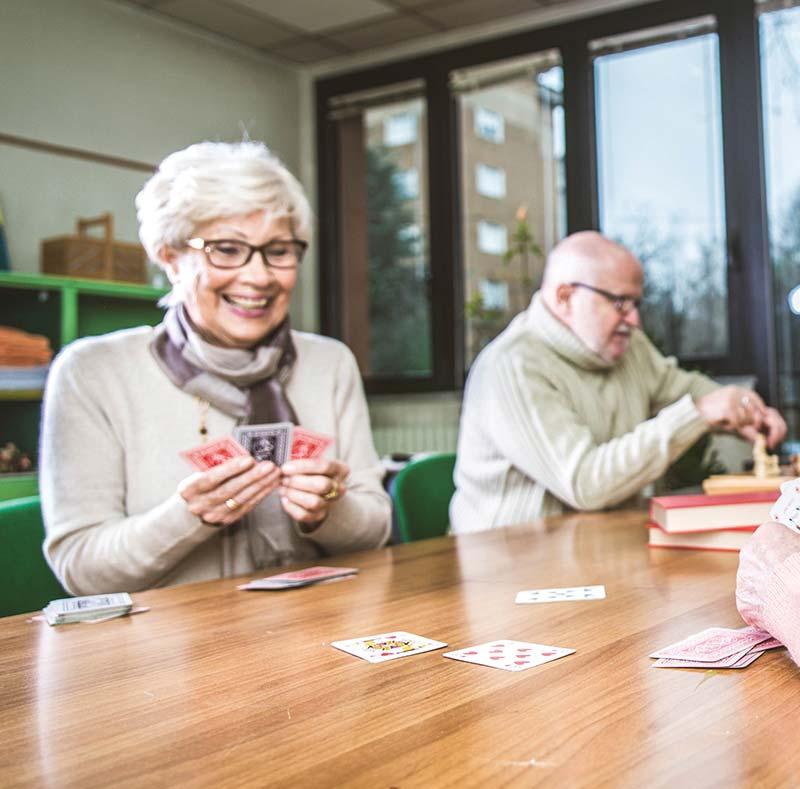 seniors playing cards at aston gardens tampa bay