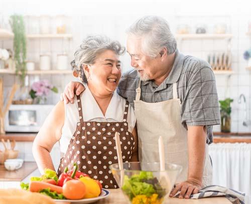 Aston Gardens Couple Preparing Heart-Healthy Foods