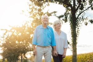 senior couple taking a stroll outside their Independent Senior Living Homes in Tampa FL